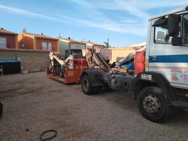 transporte maquinaria obra